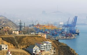 Container terminal at Vladivostok Cargo port, a view from a hill on Churkin Peninsula.  Golden Horn bay and  downtown Vladivostok are hidden in mist. Russia